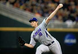 FILE - In this June 15, 2015, file photo, Florida pitcher A.J. Puk (10) delivers against Virginia in the fifth inning of an NCAA College World Series baseball game at TD Ameritrade Park in Omaha, Neb. Puk is a top prospect in the Major League Baseball draft. (AP Photo/Nati Harnik, File)