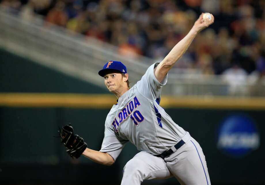 A.J. Puk, 6-foot-7 out of the University of Florida, has 95 strikeouts and 31 walks in 70 innings while posting a 2-3 record and 3.21 ERA in 15 starts. He says he knows little about the A's. Photo: Nati Harnik, Associated Press