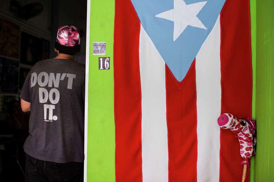 A Puerto Rican flag hangs outside a community gallery in Caguas, Puerto Rico, this week. Puerto Ricans are sharply divided over legislation designed to reboot their economy. Photo: ERIKA P. RODRIGUEZ, STR / NYTNS