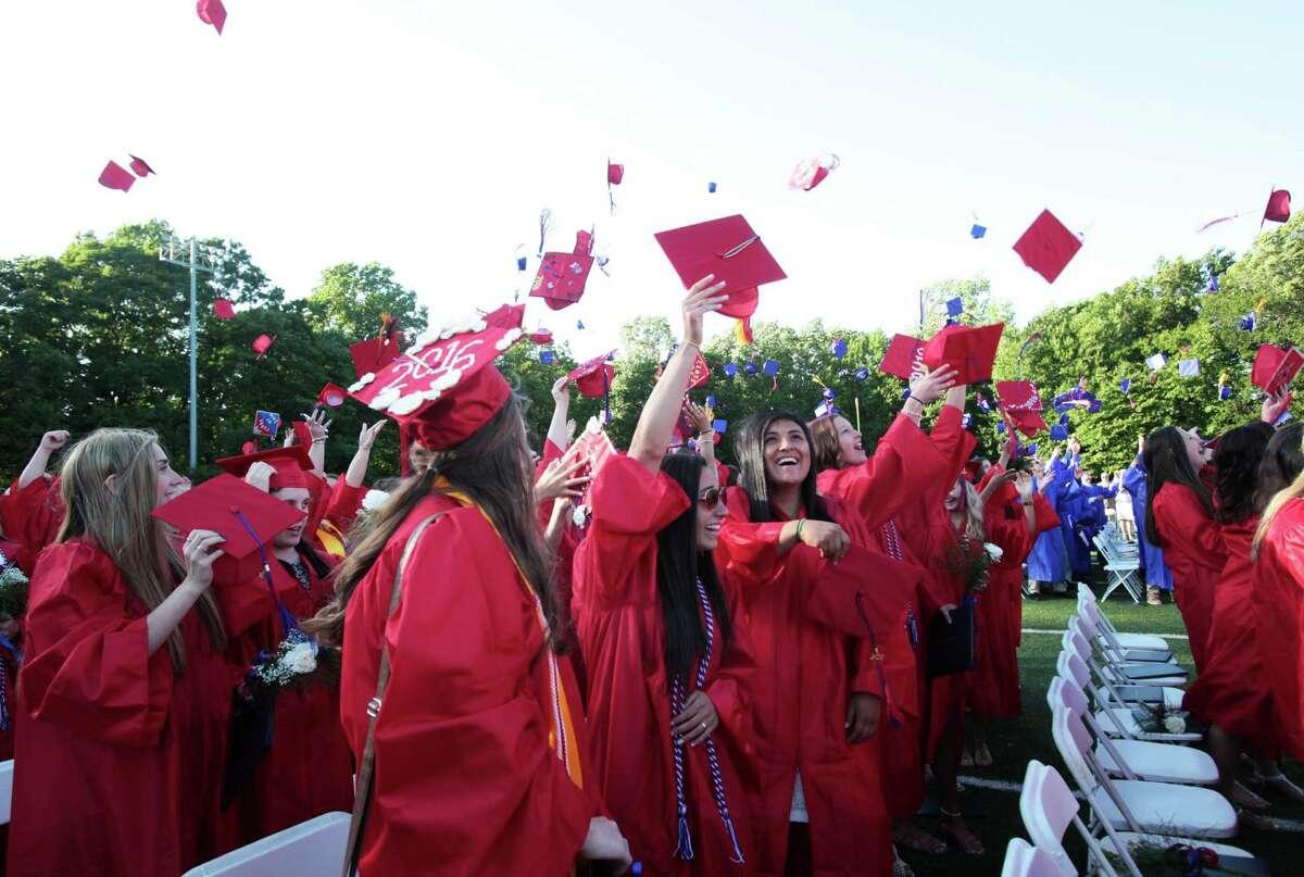 Graduates toss their caps at the Joseph A. Foran High School graduation ceremony in Milford, Conn. on Thursday, June 9, 2016.