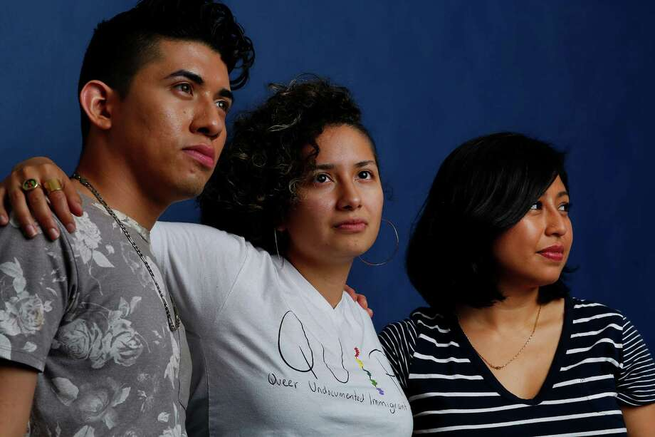 Cristina Jimenez, National Coordinator of United We Dream (UWD), right, and local dreamers Xitlali Mué±oz, center, and Adonias Arevalo, left, are among the participants of the National UWD Congress taking place in Houston from June 10 to 12. Photographed inside the Chronicle photo studio, Tuesday, June 7, 2016, in Houston. ( Mark Mulligan / Houston Chronicle ) Photo: Mark Mulligan, Staff / © 2016 Houston Chronicle