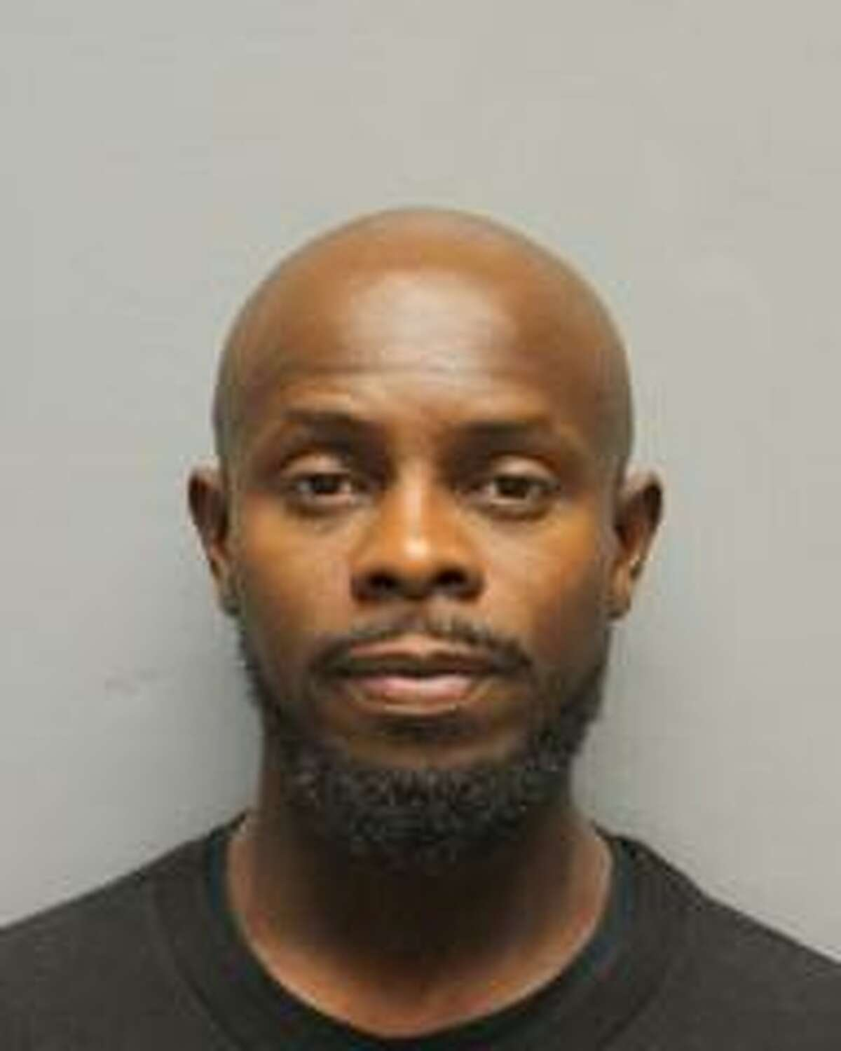 Christopher Johnson is suing Harris County, accusing jailers of choking him during his mugshot because he smiled.