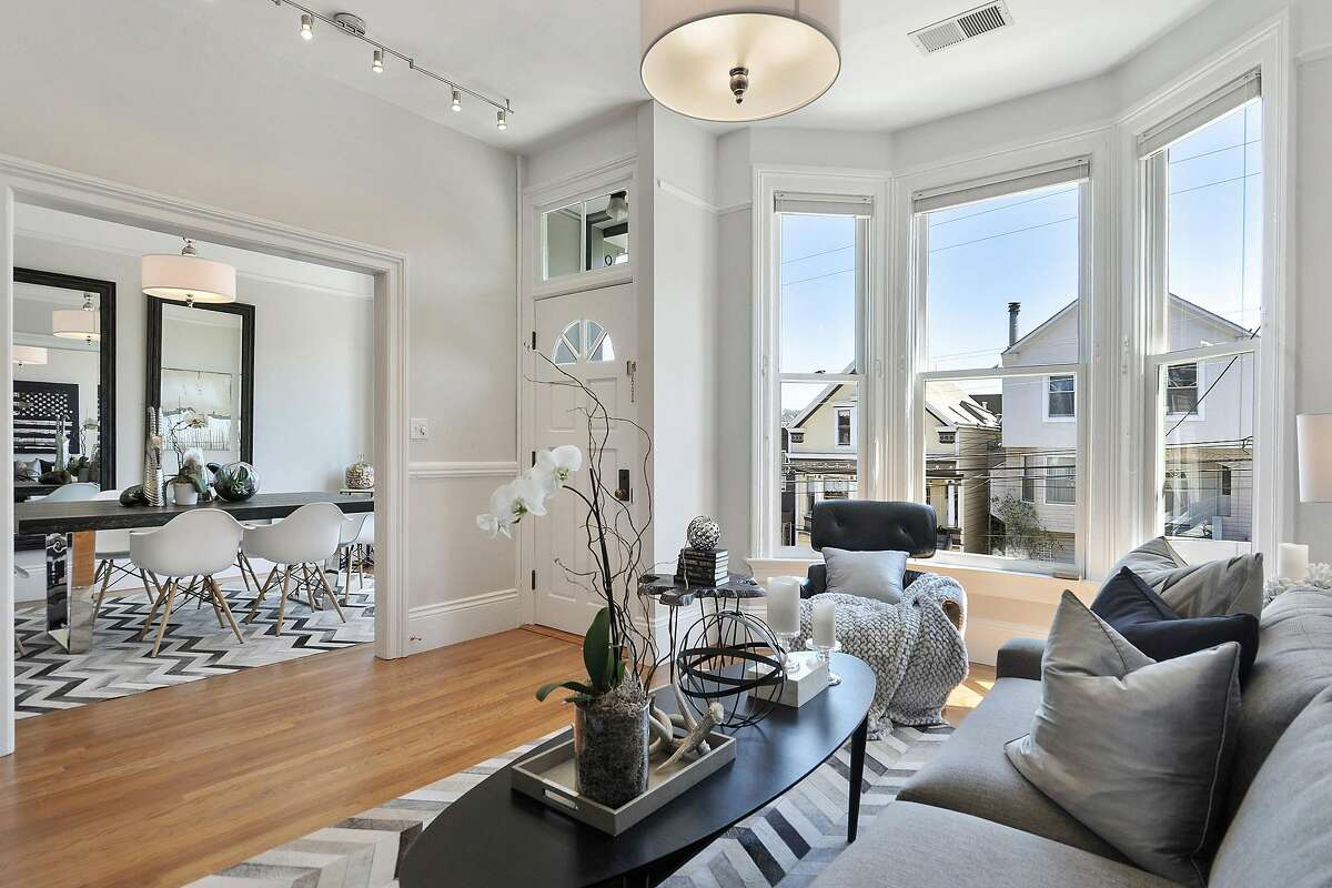 Bay windows and ceiling medallions are among the period details found within the Noe Valley condo.