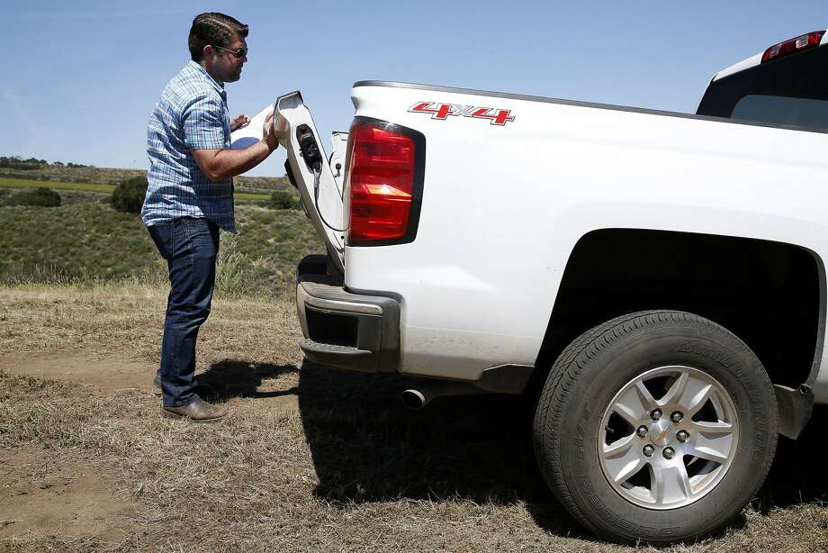 Joe Wagner closes the tailgate of a truck after a wine tasting in the Las Alturas vineyard at the Santa Lucia Highlands in Monterey County. Photo: Connor Radnovich, The Chronicle