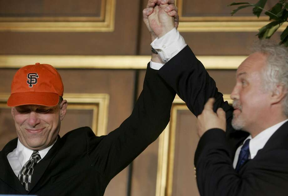 David Gockley, left, the new director of the SF Opera was joined by music director Donald Runnicles after Gockley put on a SF Giants hat. David Gockley, formerly the general director of Houston's opera, was named the general director of the San Francisco Opera. Photo: Brant Ward, San Francisco Chronicle
