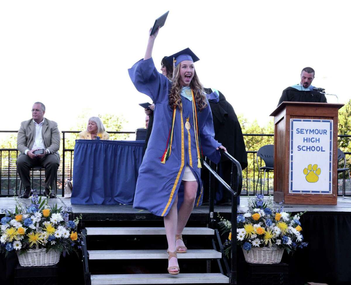 Christine Vreeland happily holds up her diploma during Seymour High School's Commencement ceremony on their campus in Seymour, Conn.. The graduation was held on Thursday June, 9, 2016.