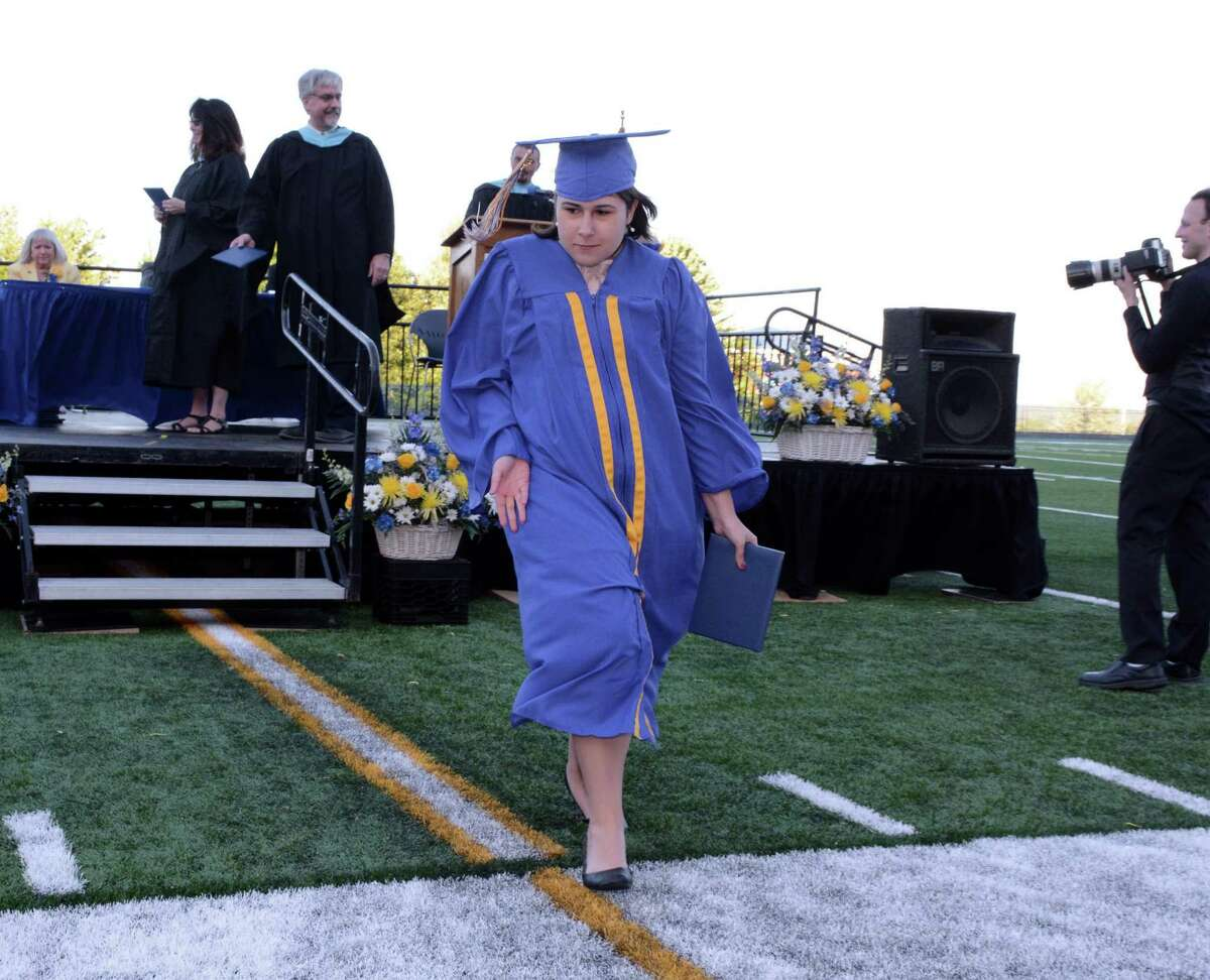 Jillian Murphy dances her way back to her seat after receiving her diploma during Seymour High School's Commencement ceremony on their campus in Seymour, Conn.. The graduation was held on Thursday June, 9, 2016.
