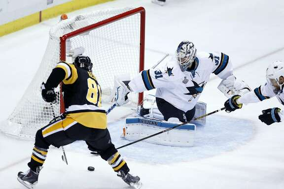 San Jose Sharks' Martin Jones stops a shot by Pittsburgh Penguins' Phil Kessel in 1st period during Game 5 of  the Stanley Cup Final at Consul Energy Center in Pittsburgh, PA, on Thursday, June 9, 2016.