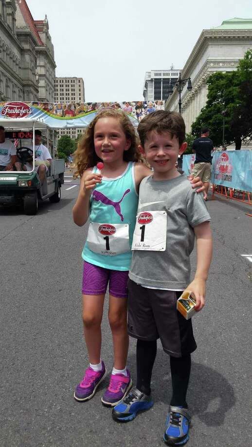 Fiona Ordway, of Albany, and Liam Moynihan of North Greenbush, participated in the 400-meter (kids) race at the June 4, 2016, Freihoffer's Run for Women. (Kathleen Moynihan)