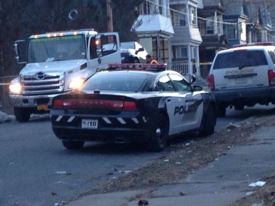 Schenectady police responded to the scene of a fatal shooting on Germania Avenue in Schenectady around 3:30 p.m. on Saturday, Jan. 30, 2016. (Amy Biancolli/Times Union)