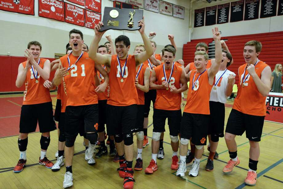 Ridgefield players celebrate following their 3-2 win over Darien in the Class L volleyball championship Thursday at Fairfield Warde High School. Photo: Matthew Brown / Hearst Connecticut Media / Stamford Advocate