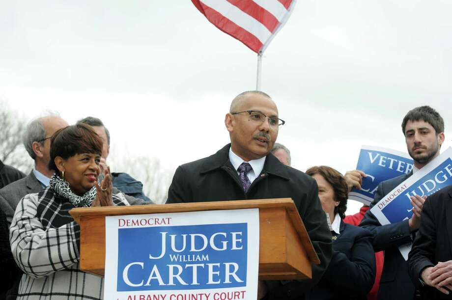 Albany City Court Judge William A. Carter surrounded by supporters at the new stairs in Lincoln Park announced his candidacy for Albany County Court Judge on Thursday April 7, 2016 in Albany, N.Y. (Michael P. Farrell/Times Union) Photo: Michael P. Farrell / 10036108A