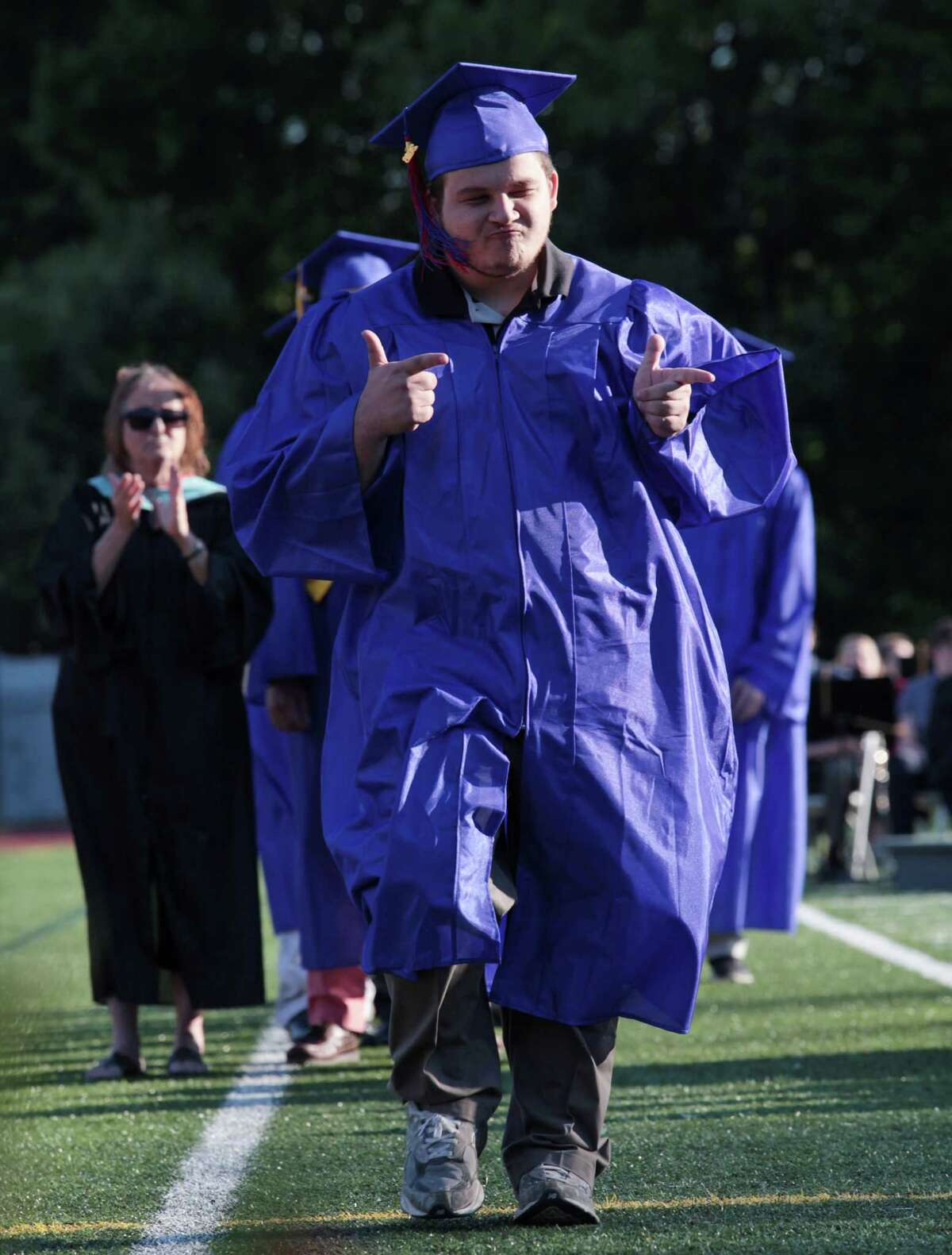Hunter Quaid Stanford reacts before receiving his diploma at the Joseph A. Foran High School graduation ceremony in Milford, Conn. on Thursday, June 9, 2016.
