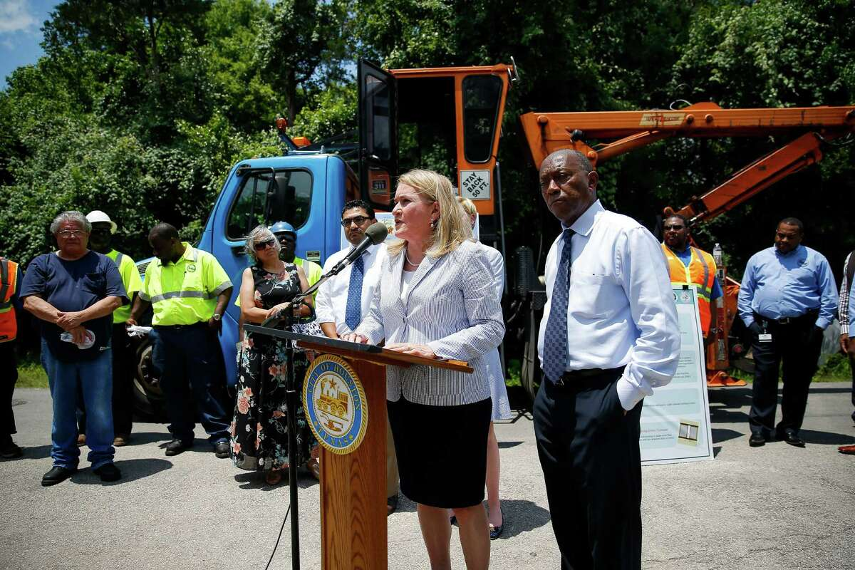 Texas senator Sylvia Garcia stands next to mayor Sylvester Turner at a press conference to urge the governor to declare a disaster in order to help the city remove breeding grounds for mosquitos that could carry the zika virus Thursday, June 9, 2016 in Houston.