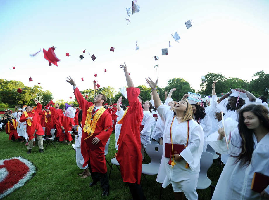 Graduates throw their caps into the air after receiving their diplomas at the Derby High School graduation ceremony Thursday at Leo F. Ryan Athletic Complex. Photo: Brian A. Pounds / Hearst Connecticut Media / Connecticut Post