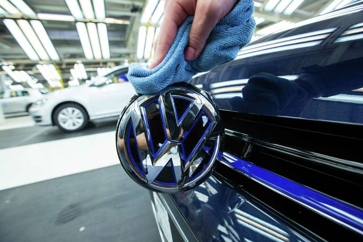 An employee polishes the VW badge on a GTE Golf hybrid at the Volkswagen factory in Wolfsburg, Germany. VW employees have told investigators that a supervisor sent clear signals that they should remove evidence before the EPA accused the automaker of manipulating emissions tests.