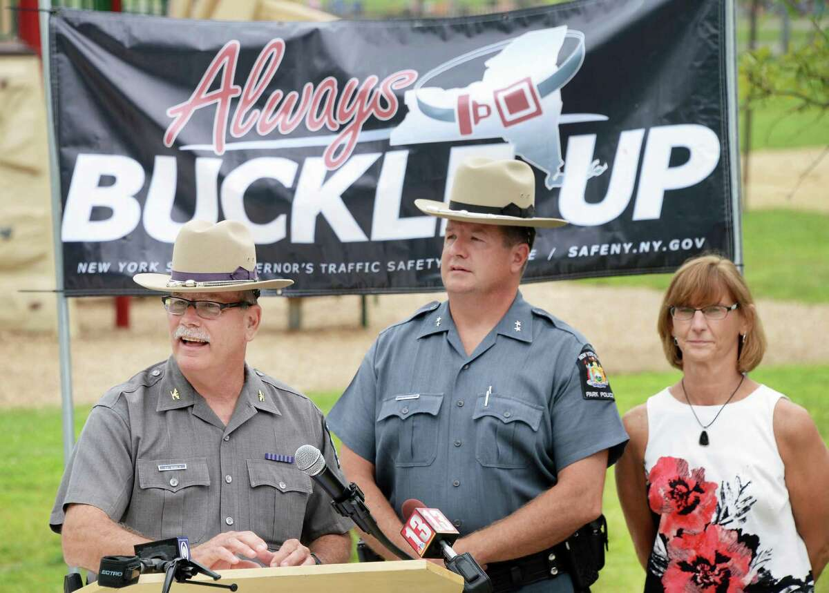 New York State Police Lt. Col. George Beach, left, New York State Parks Police Chief David Herrick and Department of Motor Vehicles Deputy Commissioner Terri Egan, right, discuss their combined efforts to encouraging visitors to our State?'s parks to buckle up for safety during a news conference at Saratoga Spa State Park Thursday July 9, 2015 in Saratoga Springs, NY. (John Carl D'Annibale / Times Union)