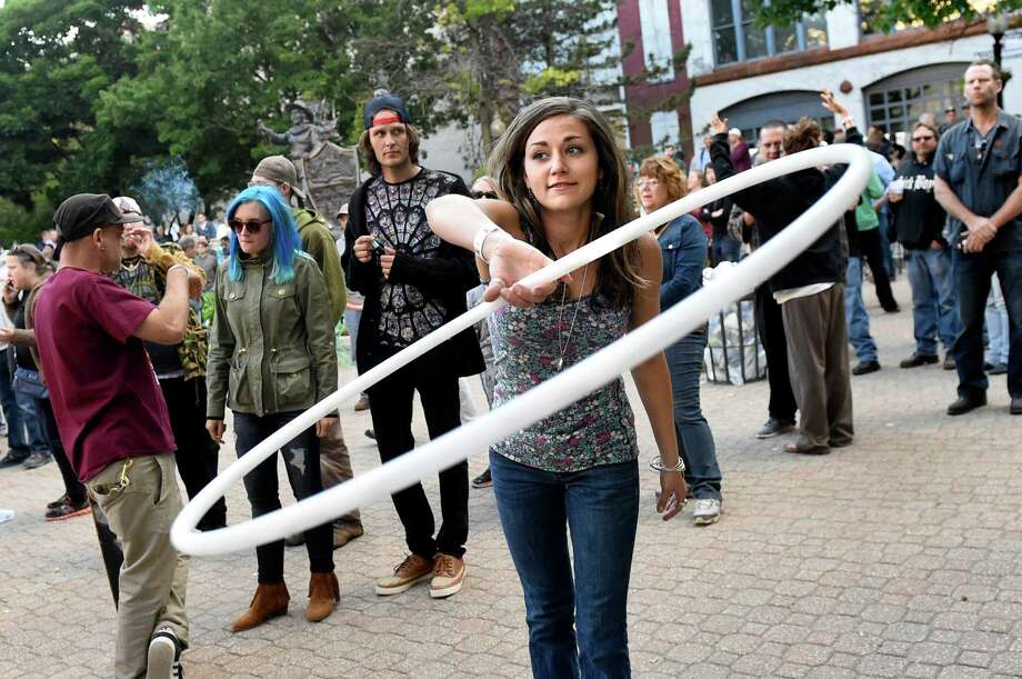 Andrea Sciubba of Albany, center, hula hoops to the music of Dr. John and The Nite Trippers during Alive at Five on Thursday, June 9, 2016, at Tricentennial Park in Albany, N.Y. (Cindy Schultz / Times Union) Photo: Cindy Schultz / Albany Times Union