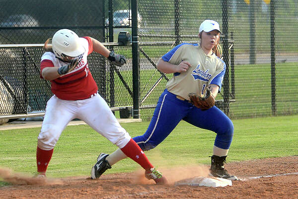 Hamshire-Fannett's Calli Saurage looks to glove the hopper as the Westside player makes her way to third at the Southeast Texas Coaches Association's All Star softball game pitting Eastside versus Westside Thursday at the Lamar softball complex. Photo taken Thursday, June 9, 2016 Kim Brent/The Enterprise