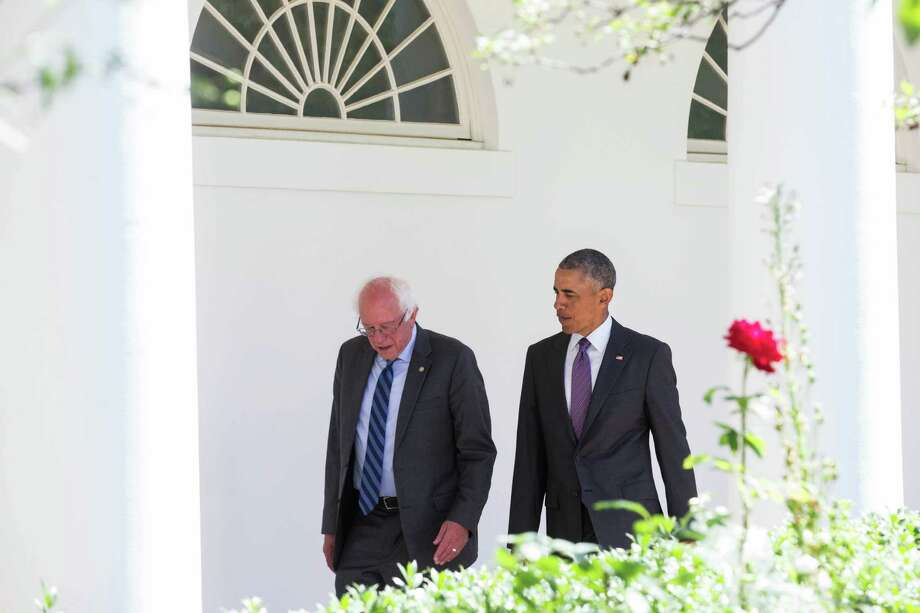 President Barack Obama and Sen. Bernie Sanders of Vermont, a Democratic presidential hopeful, walk to the Oval Office for a meeting, at the White House in Washington, June 9, 2016. The president is trying to negotiate with Sanders about exiting the race for the Democratic nomination without damaging efforts to unite the party. (Zach Gibson/The New York Times) ORG XMIT: XNYT10 Photo: ZACH GIBSON / NYTNS