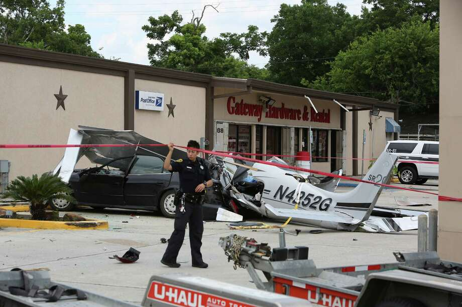 A single-engine Cirrus SR-20 crashed Thursday into a car near Hobby Airport, killing three people on board. The plane was making its third pass to the airport when the engine stalled and lost power, officials said. The plane missed power lines and a propane tank.  Photo: Steve Gonzales / © 2016 Houston Chronicle