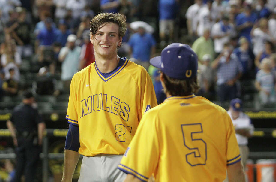 Forrest Whitley, who was the No. 17 overall pick in the MLB draft Thursday, smiles after he pitched Alamo Heights past College Station. Photo: Stephen Spillman / Stephen Spillman