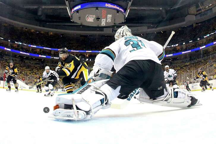 Sharks goaltender Martin Jones denies the Penguins' Nick Bonino for one of his 44 saves as San Jose held off Pittsburgh 4-2 on Thursday night. An empty-net goal by Joe Pavelski in the waning seconds clinched the win and sent the series back to San Jose.