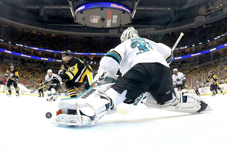 Sharks goaltender Martin Jones denies the Penguins' Nick Bonino for one of his 44 saves as San Jose held off Pittsburgh 4-2 on Thursday night. An empty-net goal by Joe Pavelski in the waning seconds clinched the win and sent the series back to San Jose. Photo: Bruce Bennett, Staff / 2016 Getty Images
