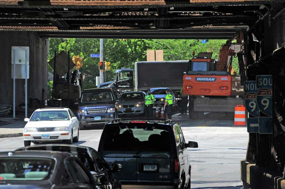 Police direct traffic Thursday as construction continues on Atlantic Street to reconfigure the northbound exit ramp of Interstate 95 and replace the Metro-North railroad bridge. Photo: Matthew Brown / Hearst Connecticut Media / Stamford Advocate