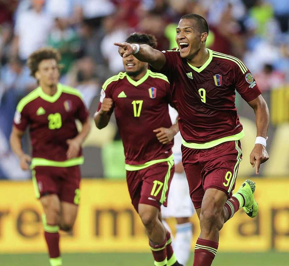 Venezuela forward Salomon Rondon, right, celebrates his goal against Uruguay. Photo: Steven M. Falk, MBR / Philadelphia Inquirer