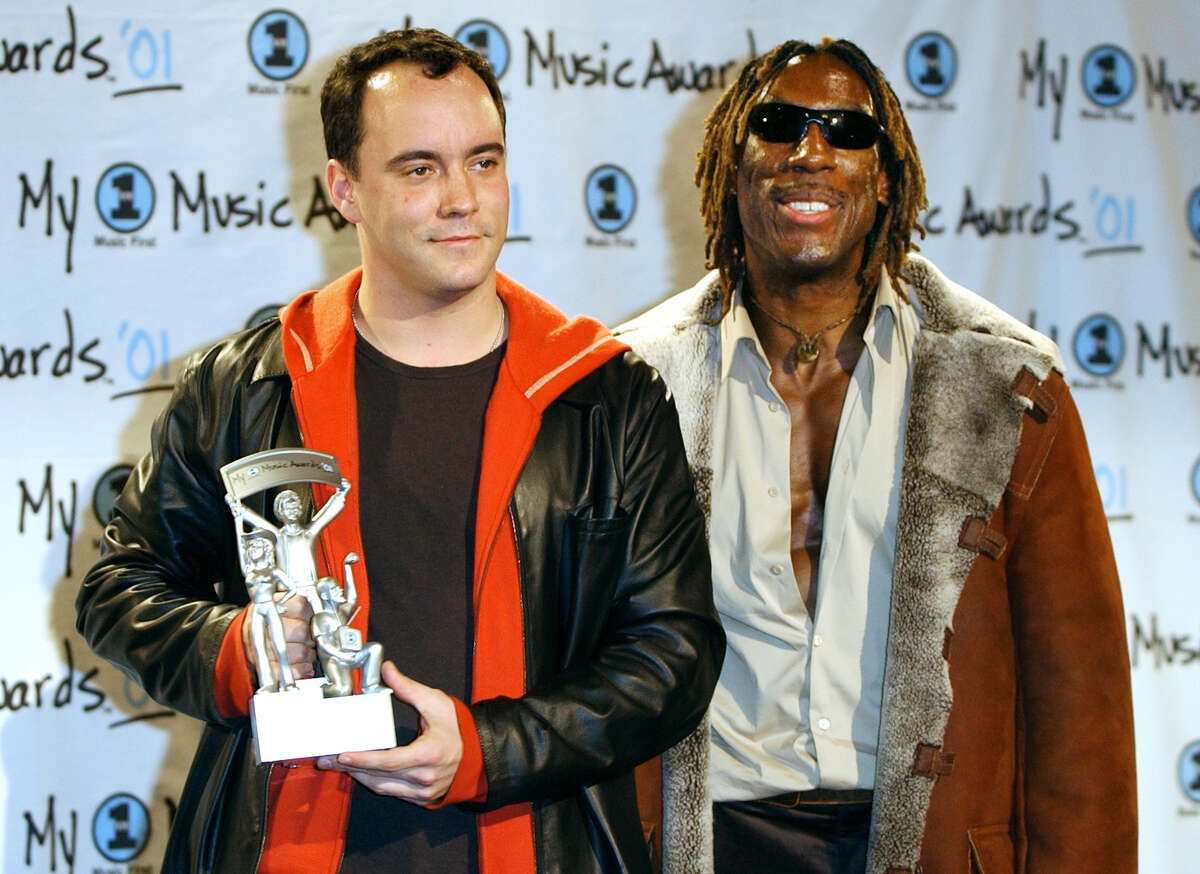 """Dave Matthews holds the Must have Album award for """"Everyday"""" with fellow band member Boyd Tinsley backsatge at the """"My VH1 Music Awards"""" Sunday, Dec. 2, 2001, at the Shrine Auditorium in Los Angeles. (AP Photo/Kevork Djansezian)"""