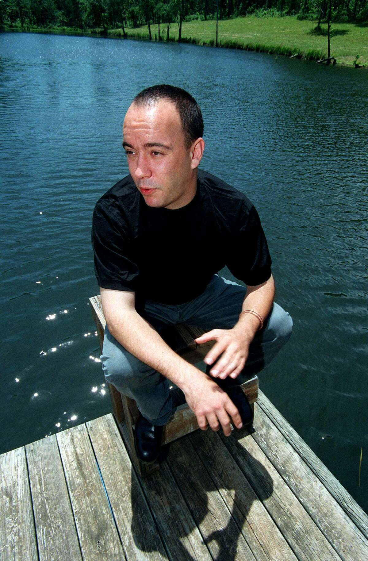 TO GO WITH STORY SLUGGED: DAVE MATTHEWS--Rock musician Dave Matthews gestures during an interview on the dock at his pond outside Charlottesville, Va., June 8, 2000. The Dave Matthews Band he heads is recording a new album and starting its biggest summer stadium tour, 52 dates over seven weeks. (AP Photo/Don Petersen)