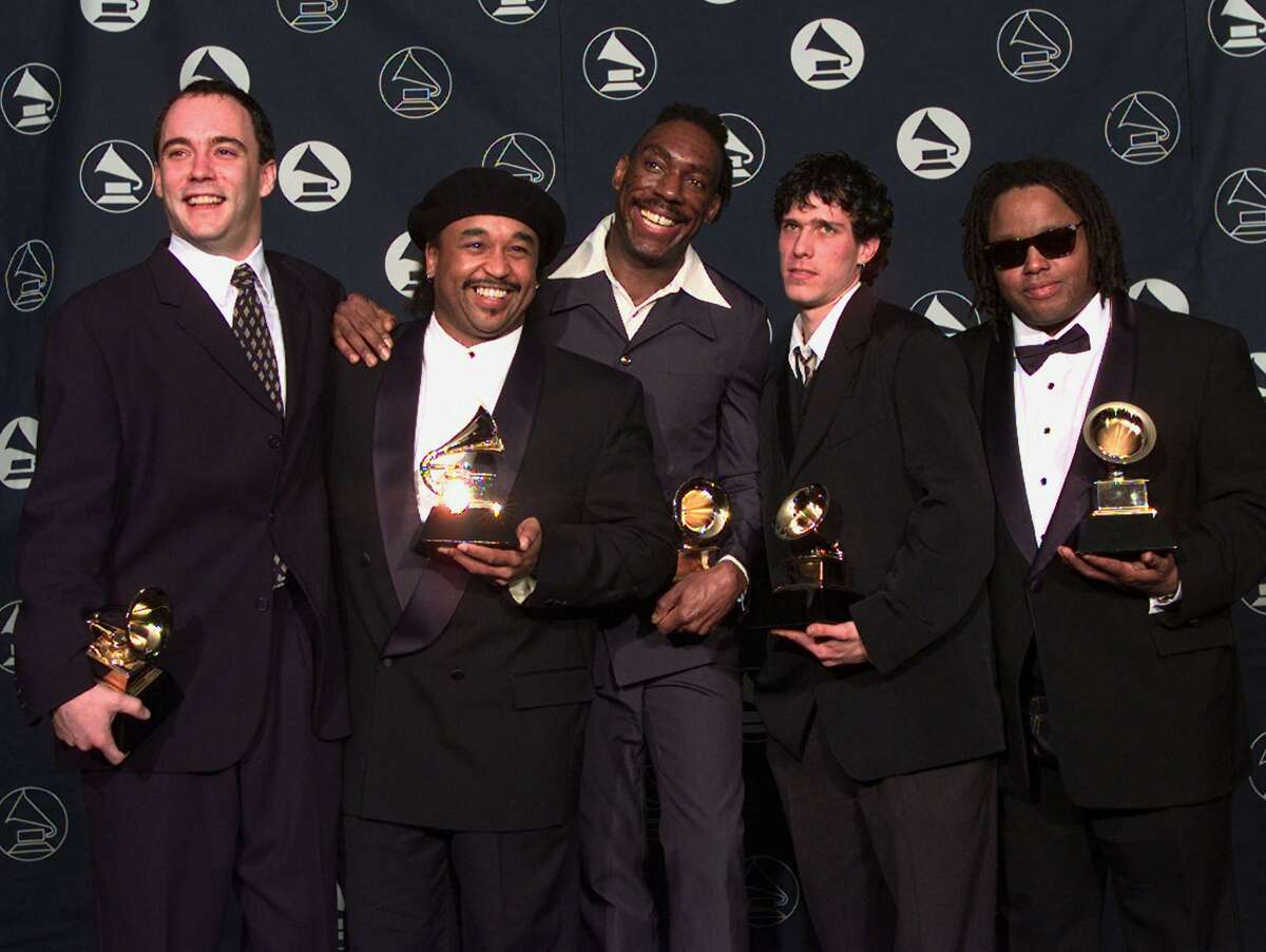 """Members of the Dave Matthews Band hold their awards for Best Rock Performance by a Duo or Group, for their work on """"So Much to Say,"""" during the 39th Annual Grammy Awards in New York Wednesday afternoon, Feb. 26, 1997. Matthews stands at far left. Saxophone player LeRoi Moore is at far right. (AP Photo/Kathy Willens)"""