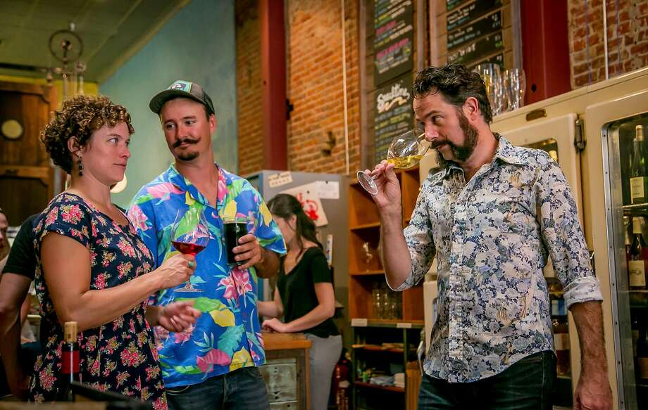 Owner Kevin Wardell, far right, talks with Seamus and Caitlin Quinn at Bergamot Alley in Healdsburg, California, on June 9th, 2016. Photo: John Storey, Special To The Chronicle