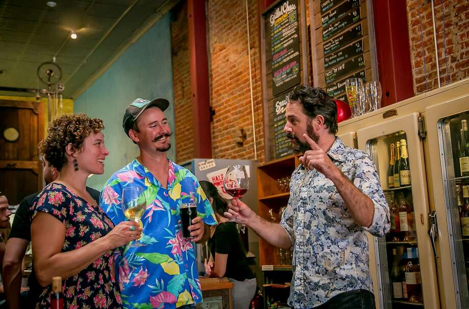 Owner Kevin Wardell (right), talks with Seamus and Caitlin Quinn at Bergamot Alley in Healdsburg. Photo: John Storey, Special To The Chronicle