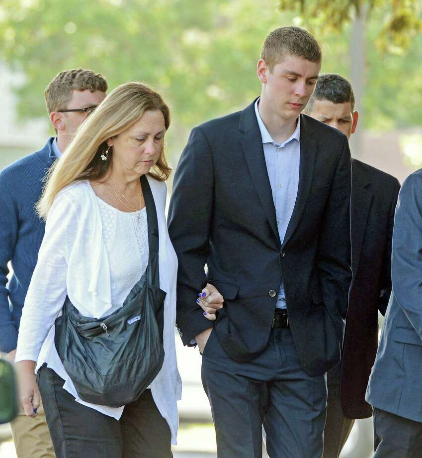 In this June 2, 2016 photo, Brock Turner, 20, right, makes his way into the Santa Clara Superior Courthouse in Palo Alto, Calif. The six-month jail term given to Turner, the former Stanford University swimmer who sexually assaulted an unconscious woman after both attended a fraternity party, is being decried as a token punishment. (Dan Honda/Bay Area News Group via AP) MAGS OUT NO SALES ORG XMIT: CAJOS101 Photo: Dan Honda / Bay Area News Group
