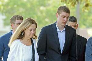 In this June 2, 2016 photo, Brock Turner, 20, right, makes his way into the Santa Clara Superior Courthouse in Palo Alto, Calif. The six-month jail term given to Turner, the former Stanford University swimmer who sexually assaulted an unconscious woman after both attended a fraternity party, is being decried as a token punishment. (Dan Honda/Bay Area News Group via AP) MAGS OUT NO SALES ORG XMIT: CAJOS101