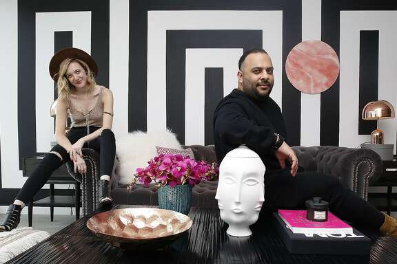 Style blogger Rebecca La Prade (left) and interior designer Michael Hilal (right) show the living room on Thursday, June 9, 2016 in San Francisco, Calif.