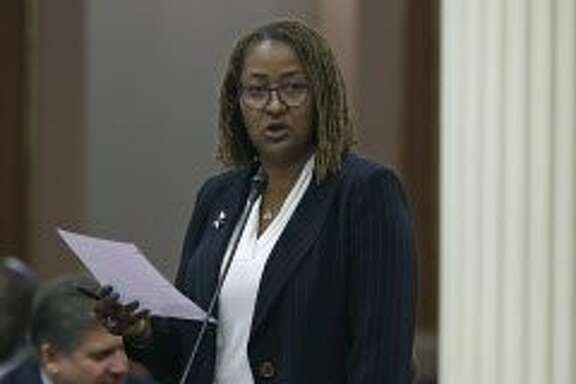 Sen. Holly Mitchell, D-Los Angeles, speaks on a measure before the Senate, Thursday, June 2, 2016, in Sacramento, Calif. By a 22-14 vote, the Senate approved Mitchell's bill, SB966, Thursday, that would end a practice of extending jail and prison sentences for repeat drug offenders. The measure now goes to the Assembly. (AP Photo/Rich Pedroncelli)