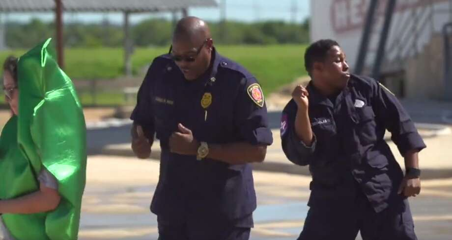 The San Antonio Fire Department extinguishes flames daily, but can bring smokin' dance moves to a dance floor if given the chance, a new video reveals. Photo: Courtesy Of SAFD