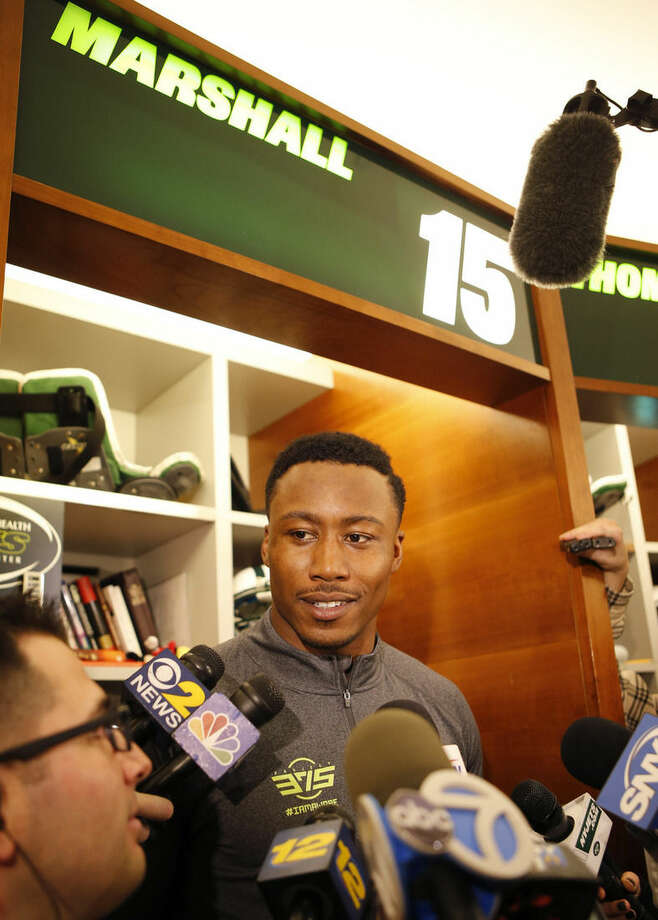 New York Jets wide receiver Brandon Marshall speaks to the media in front of his locker at the team's NFL football training facility Wednesday, Dec. 30, 2015, in Florham Park, NJ. The Jets are preparing for Sunday's game against the Buffalo Bills and their former coach, Rex Ryan, who now coaches the Bills. If the Jets defeat the Bills, they'll earn a wild card spot in the playoffs. (AP Photo/Kathy Willens)