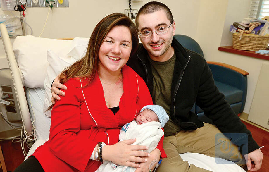 Hour photo / Erik Trautmann Stephanie Scofield and Anthony Taliercio and their new baby, Anthony Josph Taliercio Jr., born 9lbs 3oz at 1:55 am at Norwalk Hospital Friday.