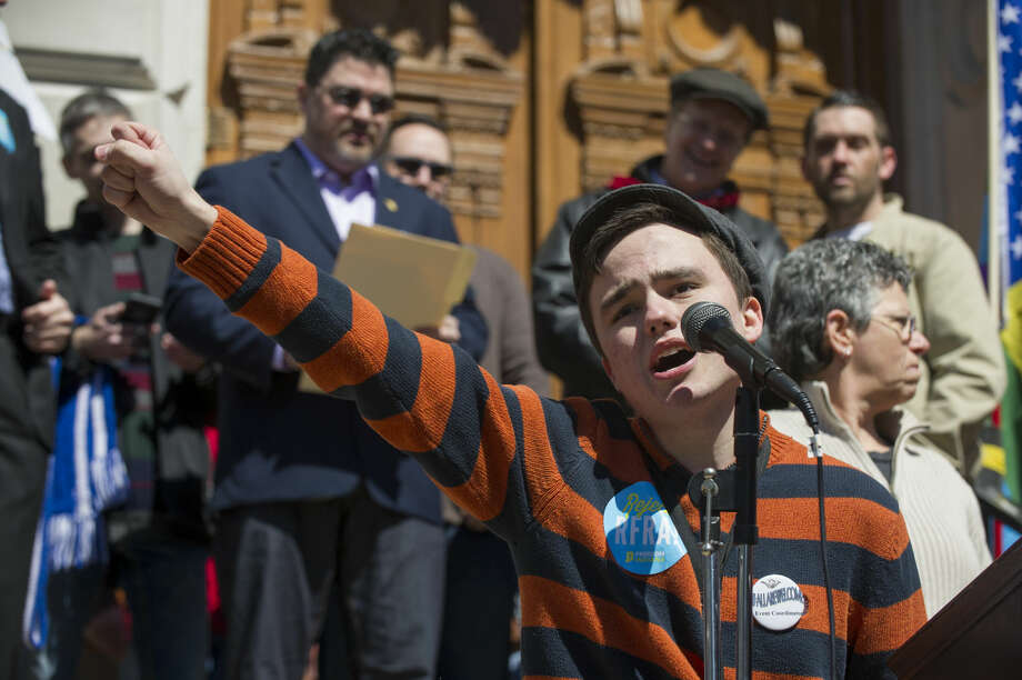FILE - In this March 28, 2015, file photo, Jackson Blanchard, of Indianapolis, leads the crowd in a chant during a rally against a new Indiana religious objections law outside the State House in Indianapolis. An intense debate over gay rights already is shaping up in Indiana, where a religious-rights law passed last spring thrust the state into the national spotlight over concerns it could sanction discrimination against gays and lesbians. (AP Photo/Doug McSchooler, File)