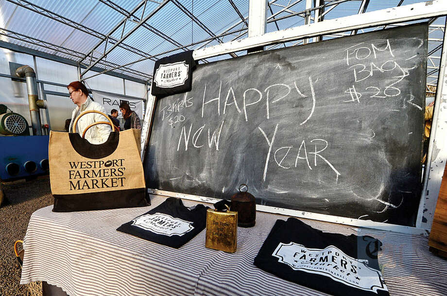 Hour photo / Erik Trautmann The Westport Farmer's Market wishes customers a Happy New year during their winter market at Gilbertie's Herb Gardens Saturday.