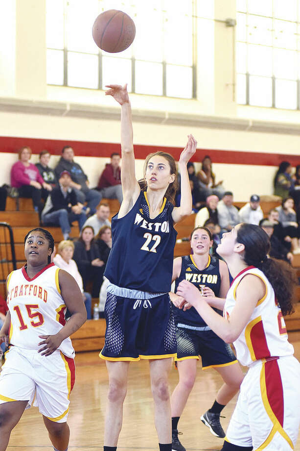 Hour photo/John Nash Weston's Bridget Mahony puts up a short jumper from the lane for a bucket in Saturday's girls basketball game against Stratford at Needham Gym in Stratford.
