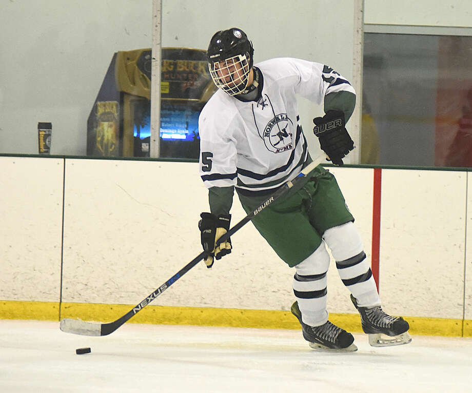 Hour photo/John Nash - Action from Saturday's Norwalk-McMahon Co-Op Hockey game against the Eastern Connecticut Eagles.
