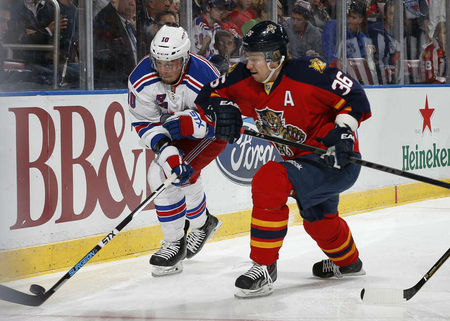 Florida Panthers forward Jussi Jokinen (36) attempts to take the puck from New York Rangers center J.T. Miller (10) as they circle the net during the first period of an NHL hockey game, Saturday, Jan. 2, 2016, in Sunrise, Fla. (AP Photo/Joel Auerbach)