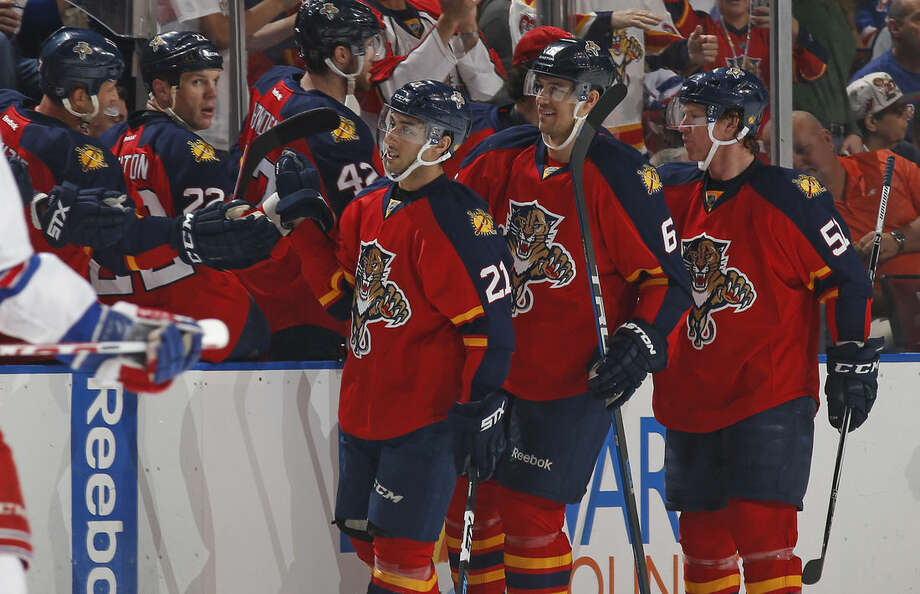 Florida Panthers forward Vincent Trocheck (21) is congratulated by teammates after scoring a goal against the New York Rangers during the second period of an NHL hockey game, Saturday, Jan. 2, 2016, in Sunrise, Fla. (AP Photo/Joel Auerbach)