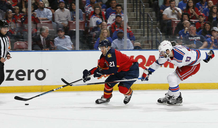 New York Rangers defenseman Keith Yandle (93) defends against Florida Panthers forward Vincent Trocheck (21) who skates in on the net during the first period of an NHL hockey game, Saturday, Jan. 2, 2016, in Sunrise, Fla. (AP Photo/Joel Auerbach)