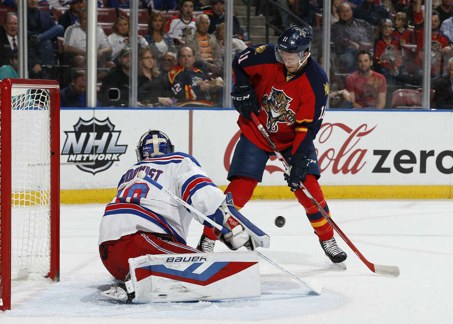 New York Rangers goaltender Henrik Lundqvist (30) stops a shot by Florida Panthers forward Jonathan Huberdeau (11) during the first period of an NHL hockey game, Saturday, Jan. 2, 2016, in Sunrise, Fla. (AP Photo/Joel Auerbach)